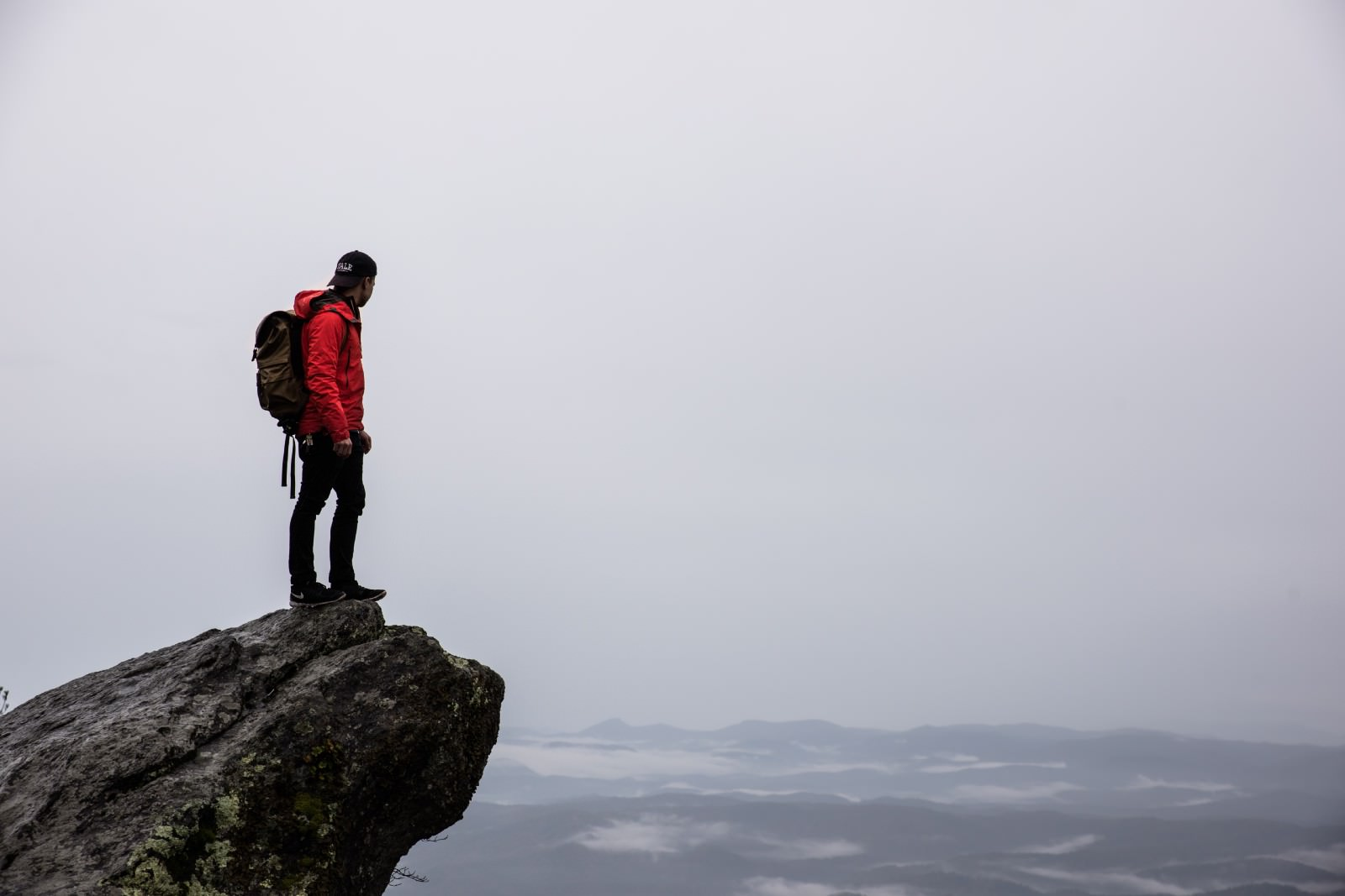 picture of man standing on a rock ledge