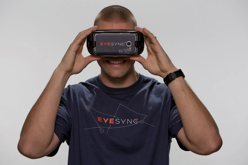 Photographic Representation of Mixed Reality, man wearing EyeSync VR (Virtual Reality) headset which is used to test for concussions in athletes.